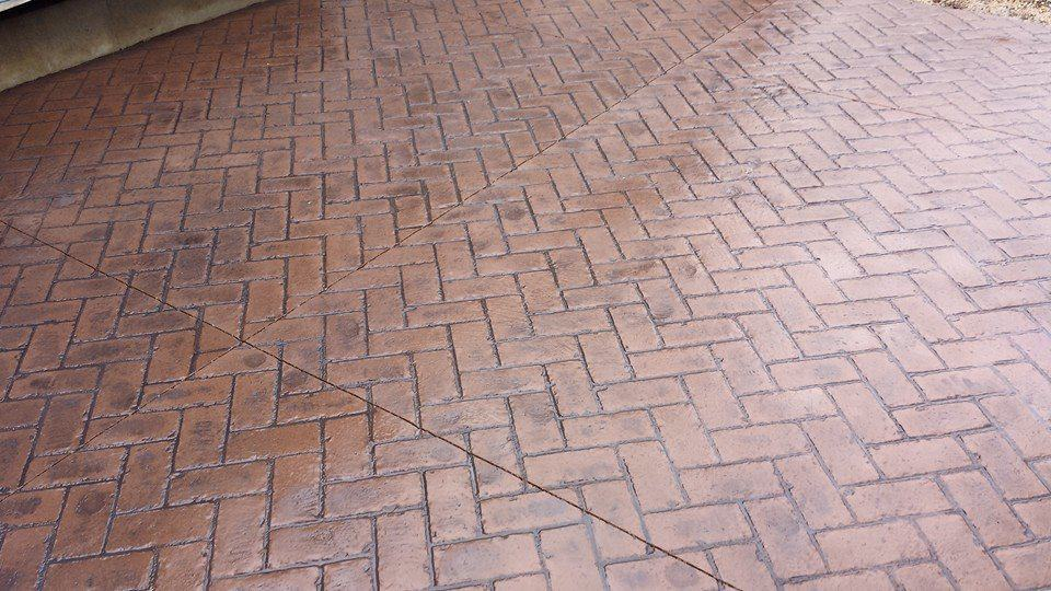 stamped concrete brick herringbone pattern project
