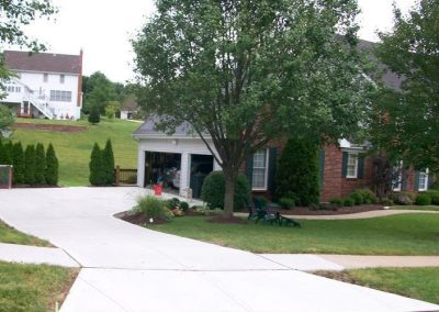 completed concrete driveway installation by local concrete company Shamrock Concrete