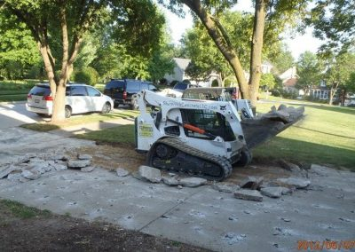 Equipment being used on new concrete driveway project in progress